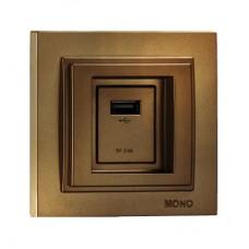 Розетка c USB-зарядкой (5В - 2.4А) серии Despina (Mono Electric). Цвет Бронза